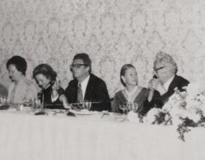 This photo was taken at an Albanian dinner at the Waldorf Astoria, NYC c.1975. My mother (far left) sitting next to Queen Geraldine of Albania followed by her son, then Prince Leka I of Albania, his wife Susan-Cullen Ward and Albanian Nationalist Ago Agaj.